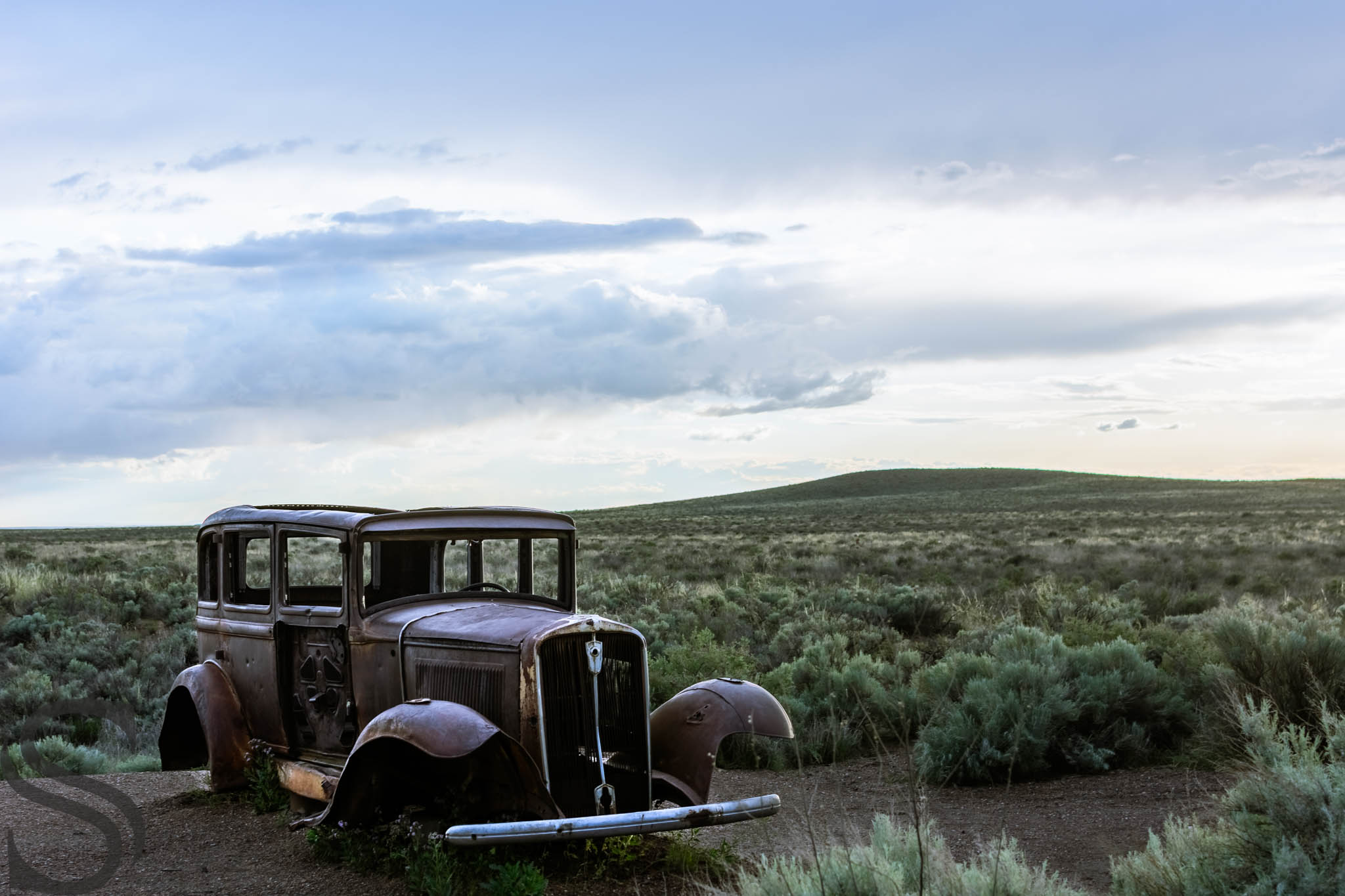 A 1932 Studebaker sits where Route 66 once cut through the park