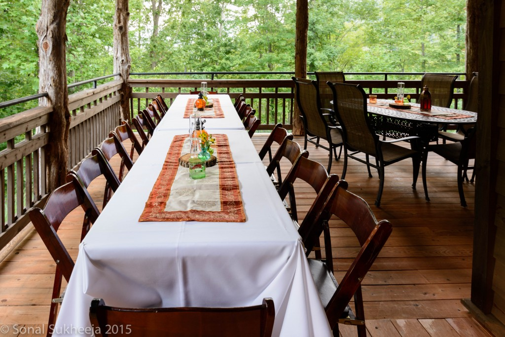Outdoor table settings at the clubhouse of Wildflower Cabins